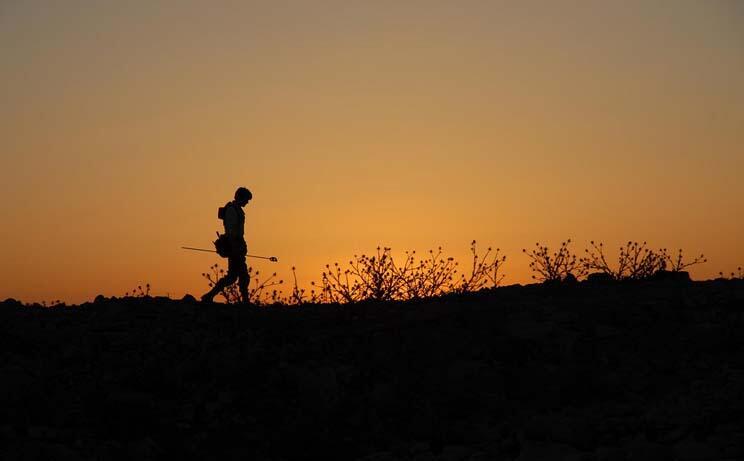 Silhouette of a surveyor at Dhiban, Jordan